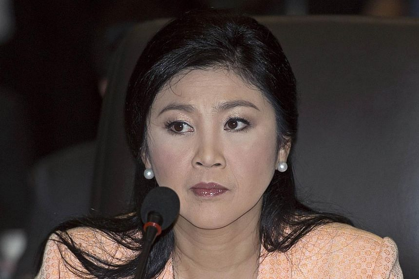 Thai Prime Minister Yingluck Shinawatra attends a meeting at the Thai Air Force Academy in Bangkok on April 30, 2014. -- FILE PHOTO: AFP