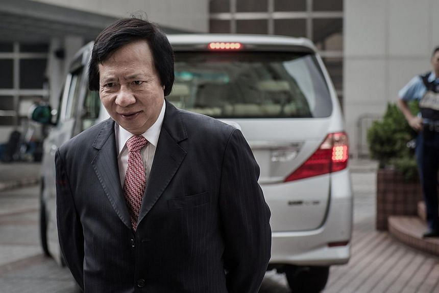 Thomas Kwok, one of the chairmen of development giant Sun Hung Kai Properties, arrives at the high court in Hong Kong on May 8, 2014. -- PHOTO: AFP