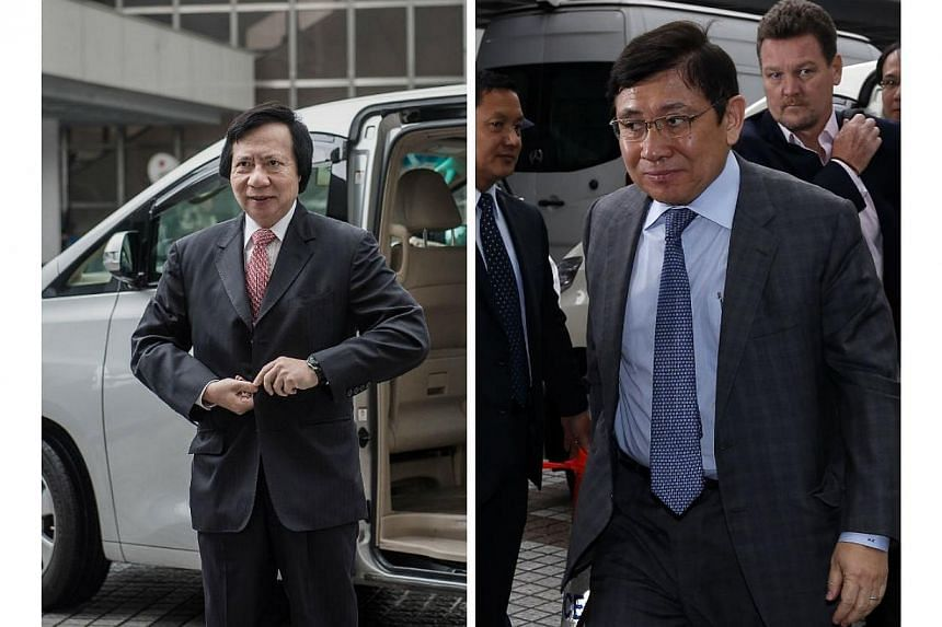 Thomas (left) and Raymond Kwok, the billionaire co-chairmen of Sun Hung Kai Properties Ltd, Asia's largest developer, went on trial on Thursday in the biggest corruption case in Hong Kong's history. -- PHOTO: AFP