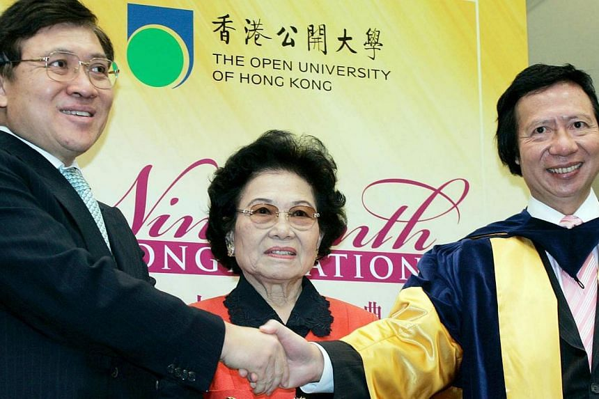 Billionaire brothers Raymond Kwok (left) and Thomas with their mother Kwong Siu-hing in a 2010 photo. -- FILE PHOTO: ORIENTAL DAILY NEWS