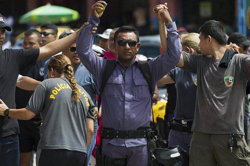 Amazonas state policemen carry out a one-day strike outside the Amadeu Teixeira stadium, next to the Arena Amazonas soccer stadium that will host World Cup matches in June, in Manaus on April 28, 2014. The police are demanding improvements in their w