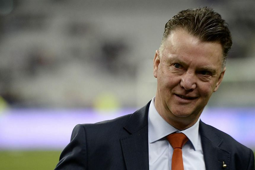 File photo of Netherlands' coach Louis van Gaal waiting for the start of a friendly football match between France and Netherlands at the Stade de France in Saint-Denis near Paris on March 5, 2014 ahead of the 2014 FIFA World Cup football tournament.