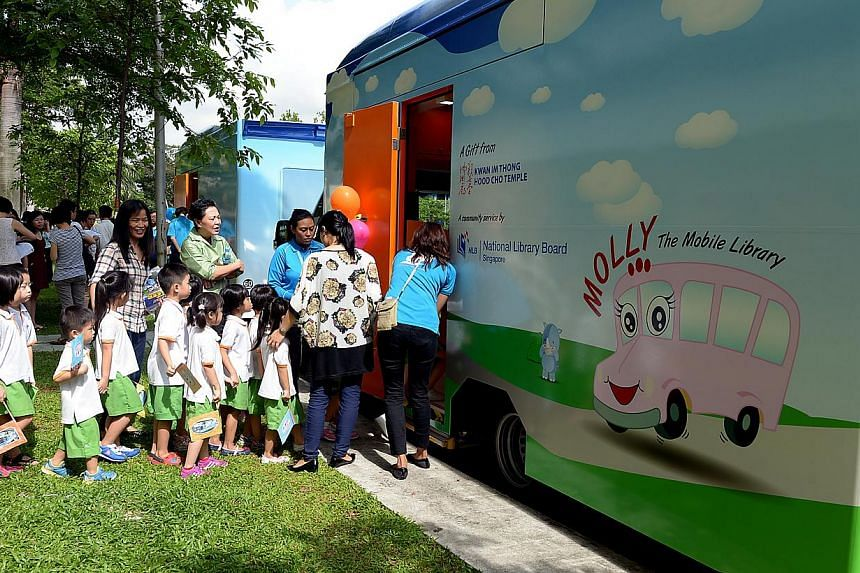 The National Library Board has launched two new mini libraries on wheels to reach out to more young children in kindergartens and childcare centres. -- BH PHOTO: TUKIMAN WARJI