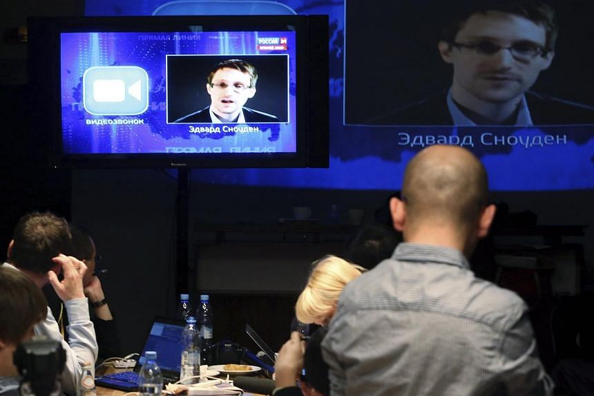 Journalists listen to a speech and question of former NSA contractor Edward Snowden at a media centre in Moscow. In a major congressional step towards curtailing widespread surveillance of millions of Americans, a House panel voted on Wednesday to en
