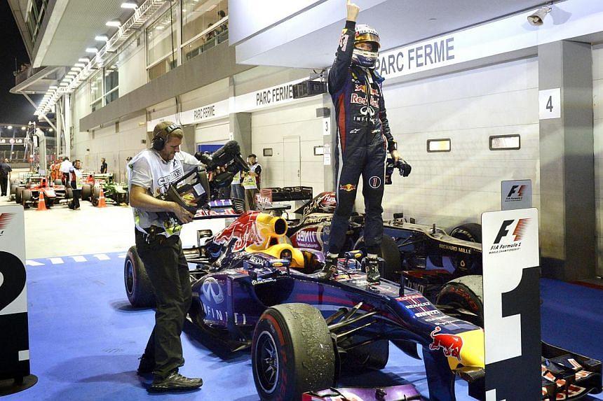Formula One (F1) driver Sebastian Vettel from Redbull racing outfit celebrates after winning the SingTel Singapore Grand Prix on 22 Sept 2013. -- ST FILE PHOTO: MUGILAN RAJASEGERAN