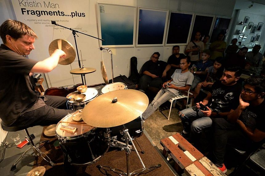Australian drummer Will Guthrie performing at an experimental music series held at gallery-cafe Artistry in Jalan Pinang. -- ST PHOTO: AZIZ HUSSIN