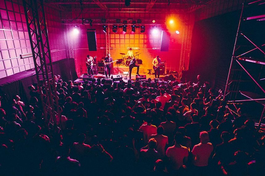 American surf-pop band The Drums performing at *Scape's ground theatre, which has a warehouse vibe, and black metal band Deafheaven (above) from the US rocking at Beep Studios in Bukit Merah Central. -- PHOTO: ALOYSIUS LIM
