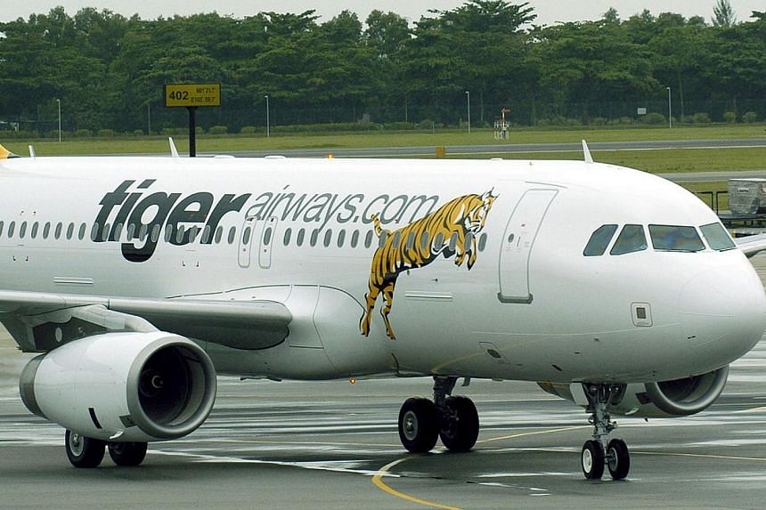 Tigerair's (above) chief executive Koay Peng Yen (top right) is stepping down next Monday. His successor is Mr Lee Lik Hsin (bottom right).