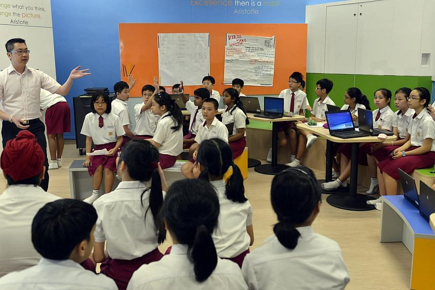 Teacher Anthony Tan conducting an English lesson with a class of Primary 6 pupils at Woodlands Primary School. Singapore's education system has won another accolade - this time in a cognitive skills and educational attainment index comparing 39 count