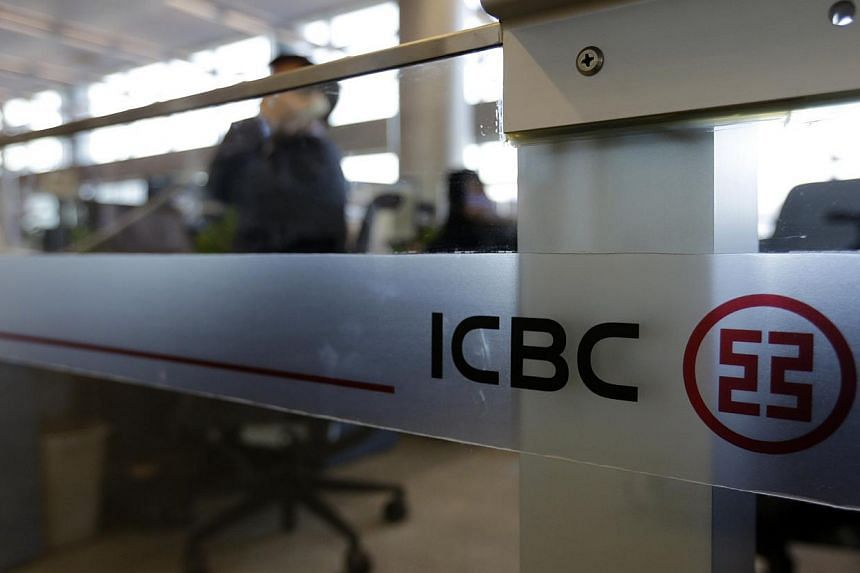An employee speaks on the phone at the headquarters of the Industrial and Commercial Bank of China Ltd (ICBC) in Beijing in this Oct 15, 2013 photo. -- FILE PHOTO: REUTERS
