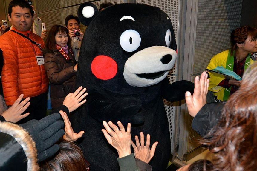 Kumamon, a clumsy bear mascot of Kumamoto prefecture attends a food products event to promote products from Kumamoto prefecture in Tokyo on Feb 23, 2014. -- FILE PHOTO: AFP