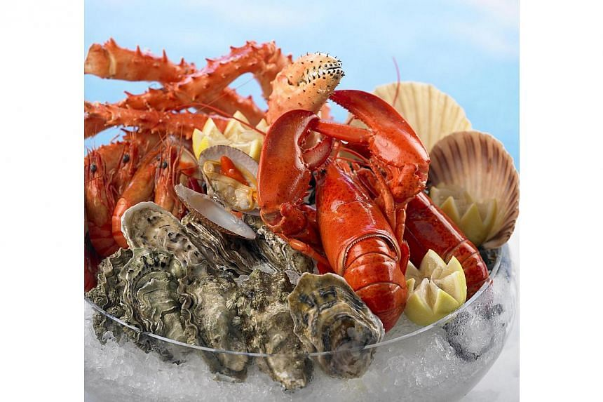 Seafood and Japanese buffet dinner at Hilton Singapore's Checkers Brasserie. -- PHOTO: HILTON SINGAPORE