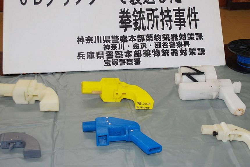 Seized plastic made guns produced by a 3-D printer are displayed at a police station in Yokohama on May 8, 2014. A 27-year-old Japanese man was arrested on Thursday for illegally possessing handguns made by a three-dimensional printer, media said, ma