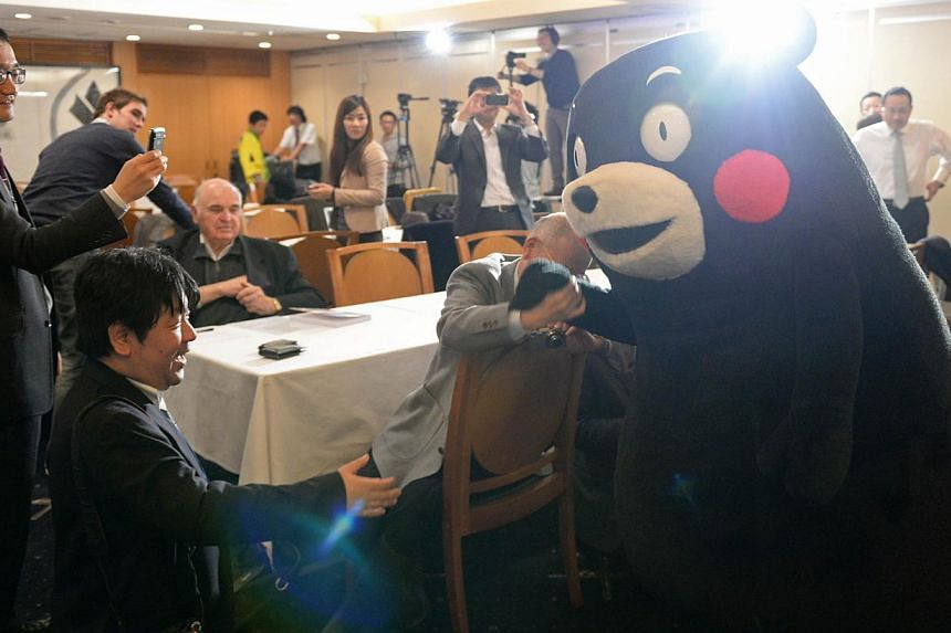 Kumamon greets journalists during a press conference at the foreign correspondents' club in Tokyo on Feb 14, 2014. -- FILE PHOTO: AFP