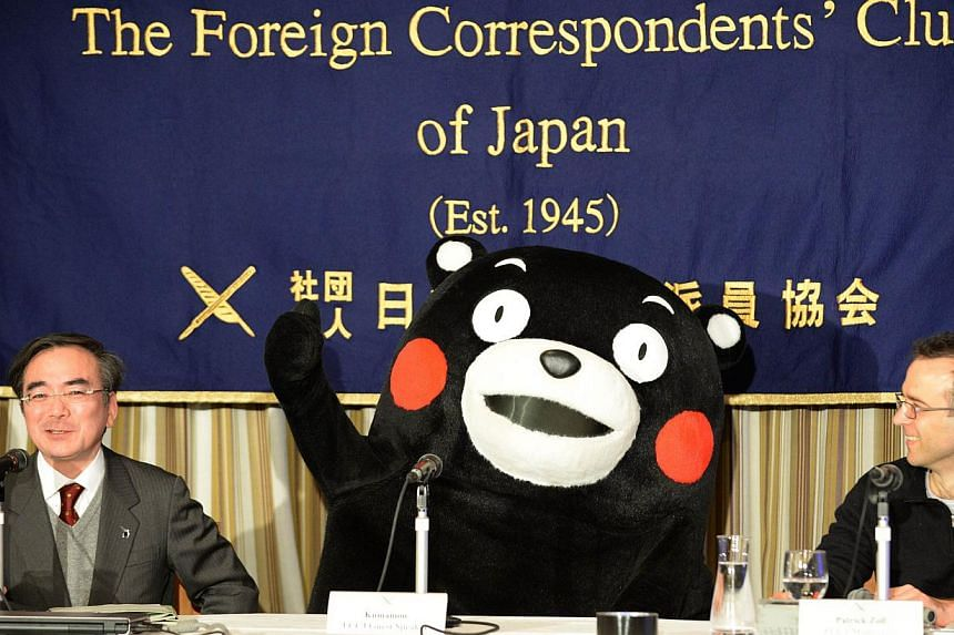 Kumamon gestures during a press conference at the foreign correspondents' club in Tokyo on Feb 14, 2014. -- FILE PHOTO: AFP