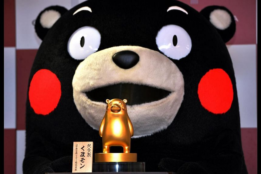 A pure gold Kumamon figure produced by Japan's jeweller Tanaka Kikinzoku Jewelry is displayed in Tokyo on May 1, 2014. -- FILE PHOTO: AFP