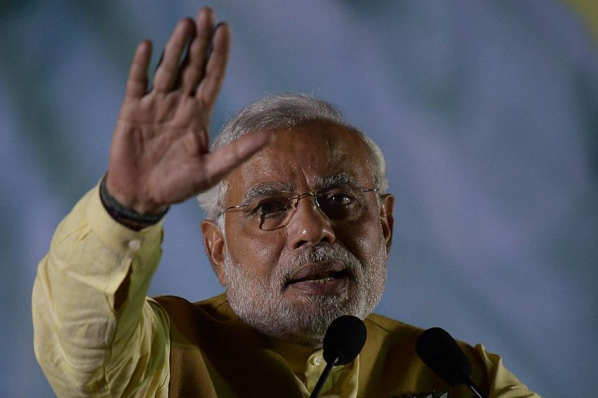 Chief Minister of the western Indian state of Gujarat and India's main opposition Bharatiya Janata Party (BJP) prime ministerial candidate Narendra Modi gestures as he speaks during a campaign rally in Kolkata on May 7, 2014. MrModi sharpened h