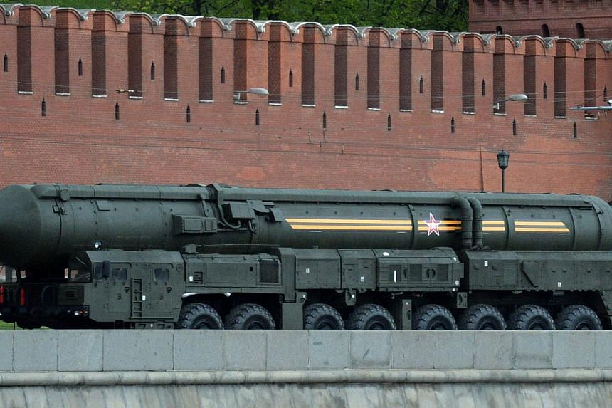 Bearing the black-and-orange St. George's Ribbon, a military valor symbol of both Imperial Russia and Soviet Union, a Russian Army's Topol intercontinental ballistic missile launcher rolls past the Kremlin in Moscow, on May 7, 2014, during a rehearsa