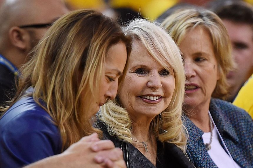 Shelly Sterling (centre), the wife of Donald Sterling owner of the Los Angeles Clippers, watches the Clippers against the Golden State Warriors in Game Four of the Western Conference Quarterfinals during the 2014 NBA Playoffs at Oracle Arena on April