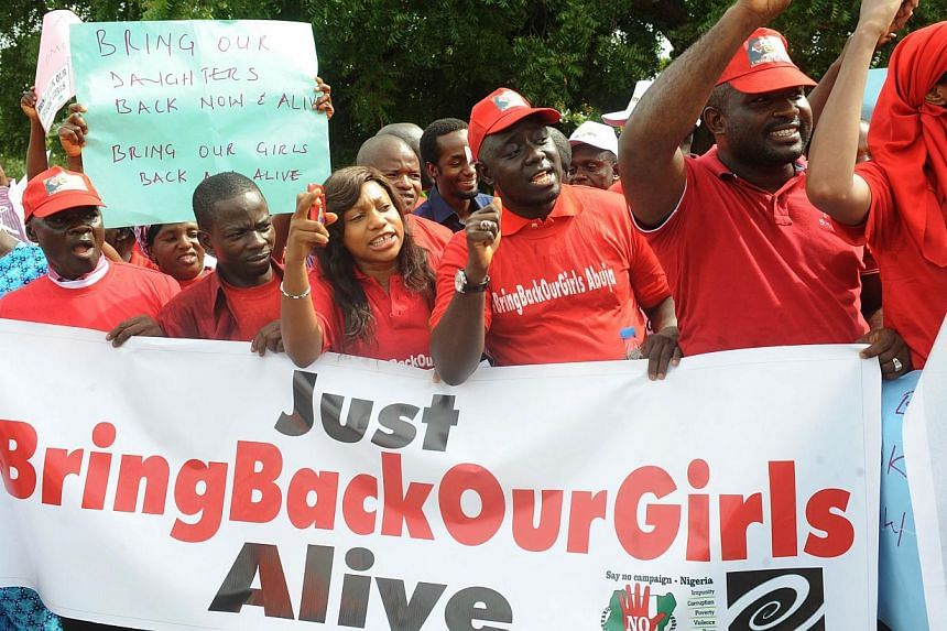 Members of civil society groups shout slogans to protest the abduction of Chibok school girls during a rally pressing for the girls' release in Abuja on May 6, 2014, ahead of World Economic Forum. World powers, including the United States and Ch