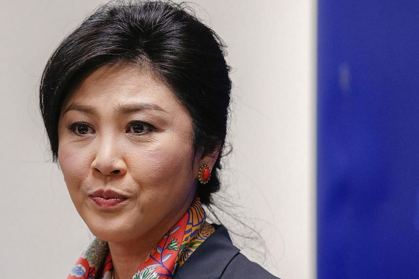 Thailand's Prime Minister Yingluck Shinawatra pauses as she addresses reporters in Bangkok on May 7, 2014. -- FILE PHOTO: REUTERS
