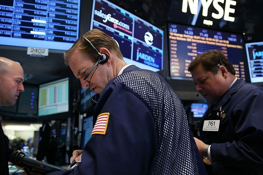 US stocks mostly fell on Thursday with the S&P 500 and the Nasdaq closing lower, led by losses in the energy and utility sectors. -- FILE PHOTO: AFP