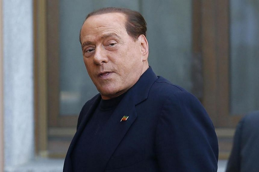 Italy's three-time former prime minister Silvio Berlusconi on Friday, May 9, 2014, arrived at a hospice for Alzheimer's patients near Milan to begin his year of community service following a conviction for tax fraud. -- PHOTO: REUTERS