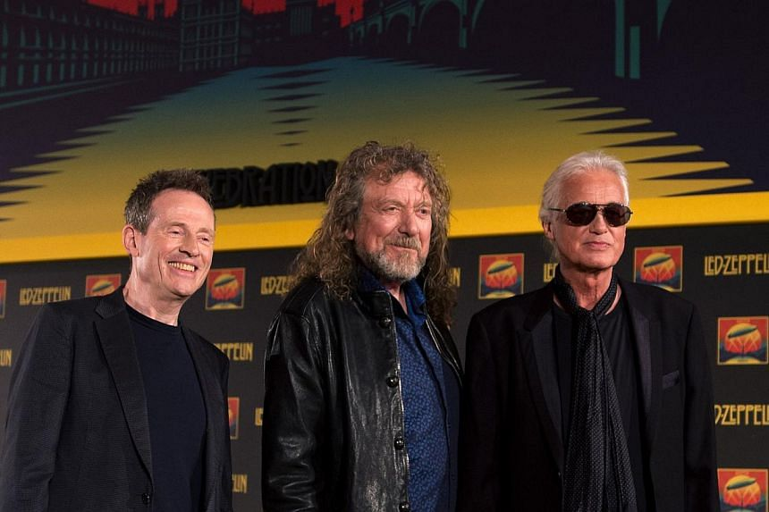 In this file picture taken on Sept 21, 2012 British rock band Led Zeppelin's (L-R) John Paul Jones, Robert Plant and Jimmy Page pose at a press conference to announce the release of a video recording of their one-off 2007 concert in London. -- FILE P