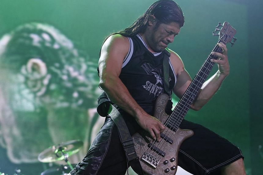 Bassist Robert Trujillo of Metallica performs during the band's Latin America tour concert at the Jockey Club in Asuncion on March 24, 2014. US metal giants Metallica will play this year's coveted Saturday night headline spot at Britain's Glasto