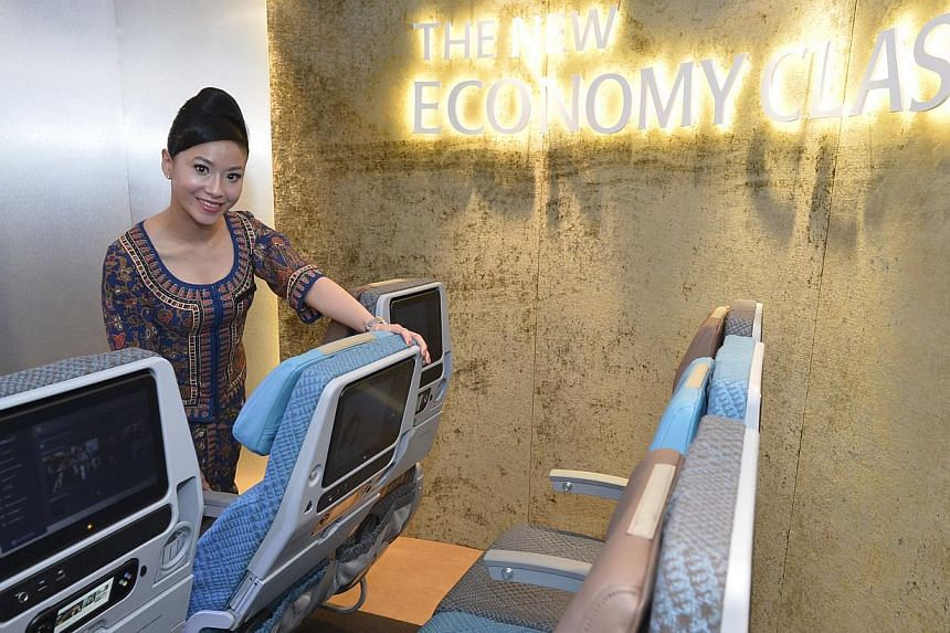 An SIA air stewardess showing the new economy class on Boeing 777-300 ER. Singapore Airlines will launch a premium economy class on its flights progressively from the second half of next year, chief executive officer Goh Choon Phong today announced a