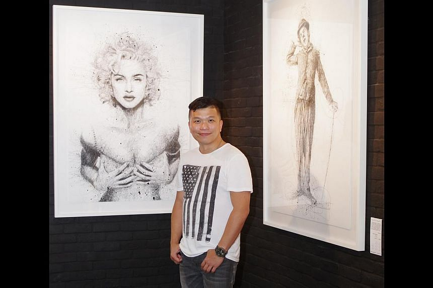 Artist Vince Low with his drawings of Marilyn Monroe and Charlie Chaplin at the gallery. -- PHOTO: ARTMANAGEMENT. COM