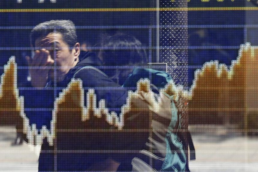 Asian shares mostly slumped on Friday as a tense situation in Ukraine made investors cautious, though a tame inflation report from China calmed some nerves. -- FILE PHOTO: REUTERS