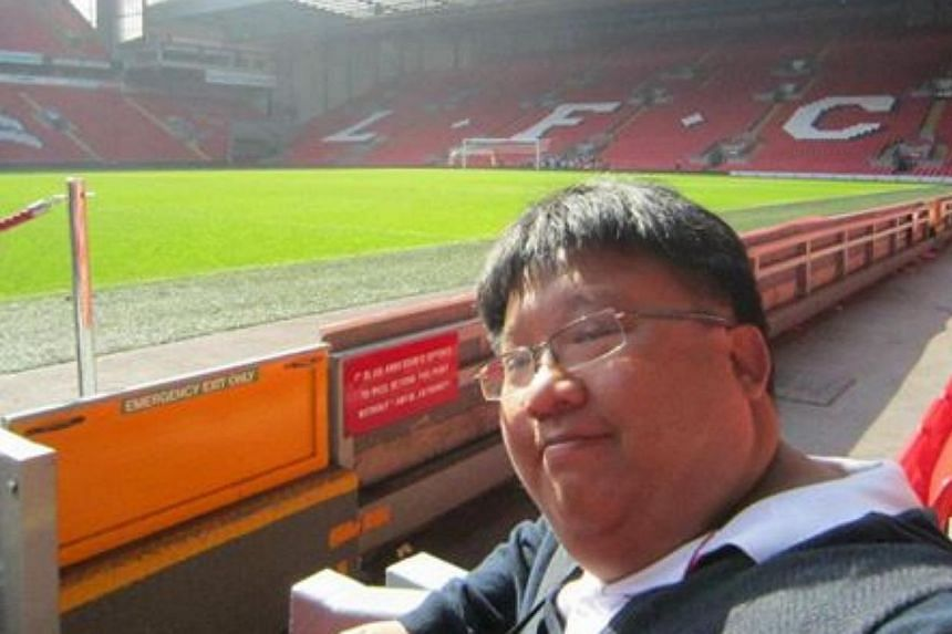 The writer with the Kop in the background during his previous Anfield trip in 2012.-- ST PHOTO: CHIA HAN KEONG