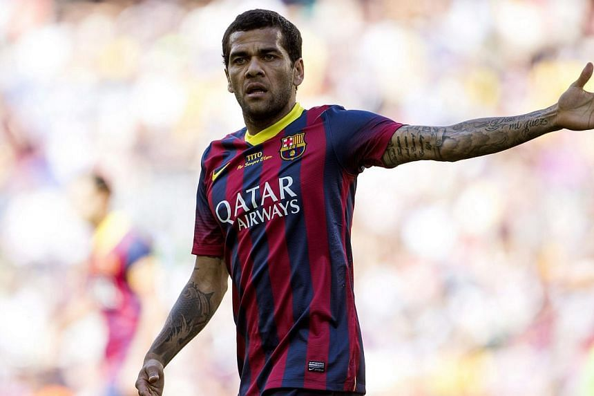 Barcelona's Brazilian defender Dani Alves has threatened to quit the club if fans fail to appreciate his performance on the field. -- FILE PHOTO: EPA