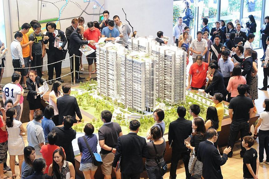 Buyers checking out the showroom at Riverbank @ Fernvale which is near the Layar LRT station. One in three home buyers do not fully understand the new Total Debt Servicing Ratio (TDSR) framework for property loans, a survey by local bank UOB has foun