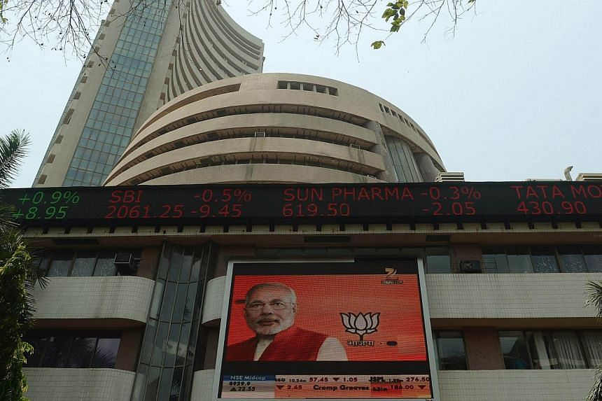 The television screen on the facade of the Indian Bombay Stock Exchange (BSE) building features Chief Minister of the Indian state of Gujarat and Bharatiya Janata Party (BJP) prime ministerial candidate Narendra Modi, in Mumbai on April 22, 2014. --