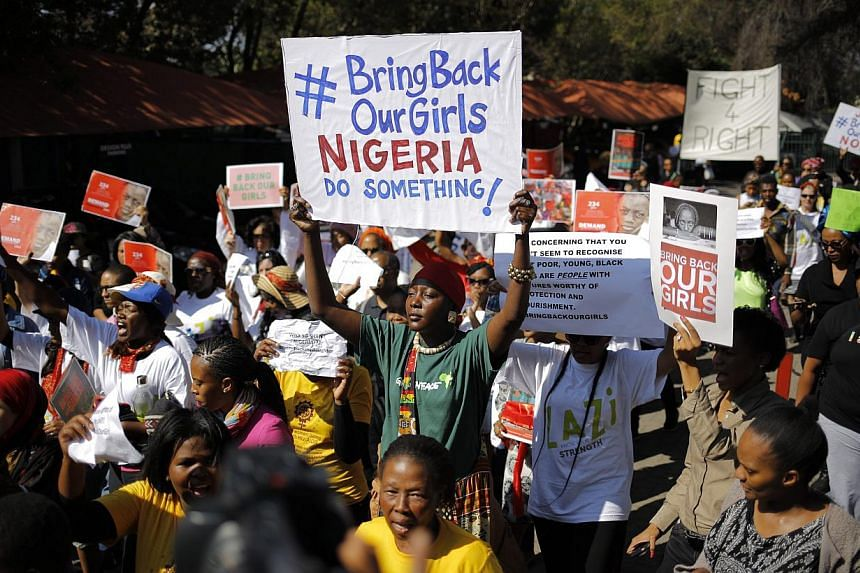 Some of the hundreds of protesters demonstrating outside the Nigerian consulate in Johannesburg, South Africa, on May 8, 2014, to bring attention to the girls abducted in Nigeria. -- PHOTO: EPA