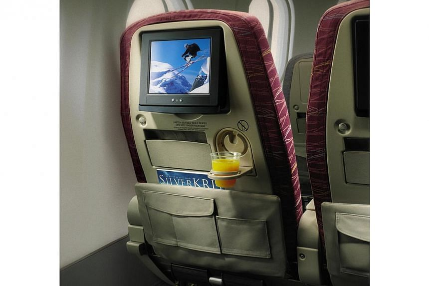 Singapore Airlines (SIA) is the first airline to replace all economy seats on a plane with premium economy ones on the two non-stop flights to Los Angeles and New York.-- FILE PHOTO: SIA