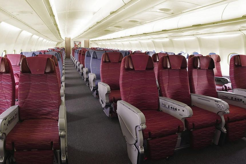 Seven seats spanning each row. Singapore Airlines announced on Friday it will introduce premium economy class from the second half of next year. We look at the airline's history with premium economy class.-- FILE PHOTO: SIA