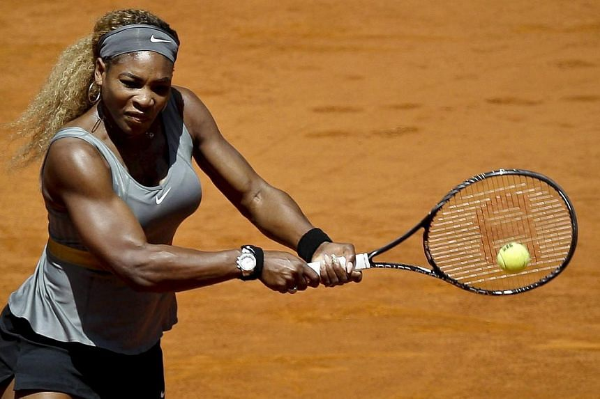 US tennis player Serena Williams returns to Spaniard Carla Suarez during their third round match for the Mutua Open Madrid Masters 1000 tennis tournament in Madrid, Spain on May 8, 2014. Williams has pulled out of tennis' Madrid Open with a thigh inj