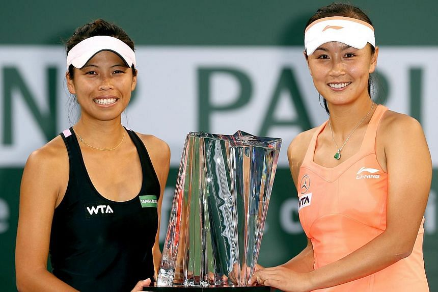 Taiwan's Hsieh Su-wei (left) will join her doubles partner, Peng Shuai of China, as joint No. 1 in the news doubles ranking to be released by the Women's Tennis Association on Monday, May 12, 2014.-- FILE PHOTO: AFP