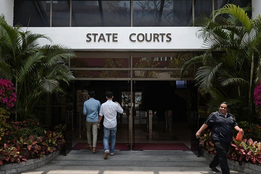 People entering and leaving the State Courts on March 7, 2014. -- ST FILE PHOTO:MARK CHEONG