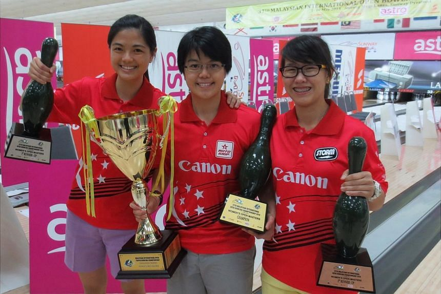 The Republic's keglers Daphne Tan, Cherie Tan and Joey Yeo (left to right) achieved an all-Singaporean podium sweep at the 37th Malaysian International Open. -- PHOTO: SINGAPORE BOWLING