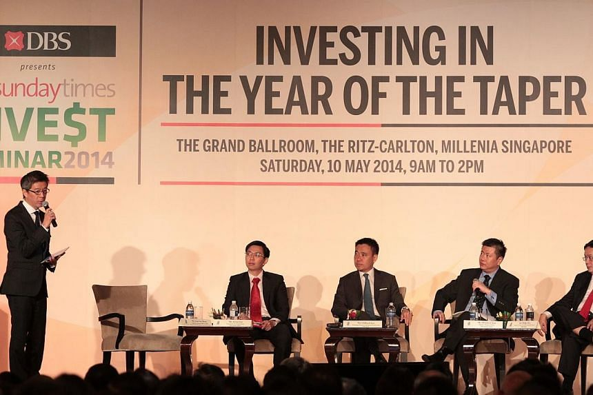 Panel discussion regarding investment strategies at The Sunday Times Invest Seminar held on May 10 at the Ritz-Carlton, Millenia Singapore.-- ST PHOTO:NEO XIAOBIN