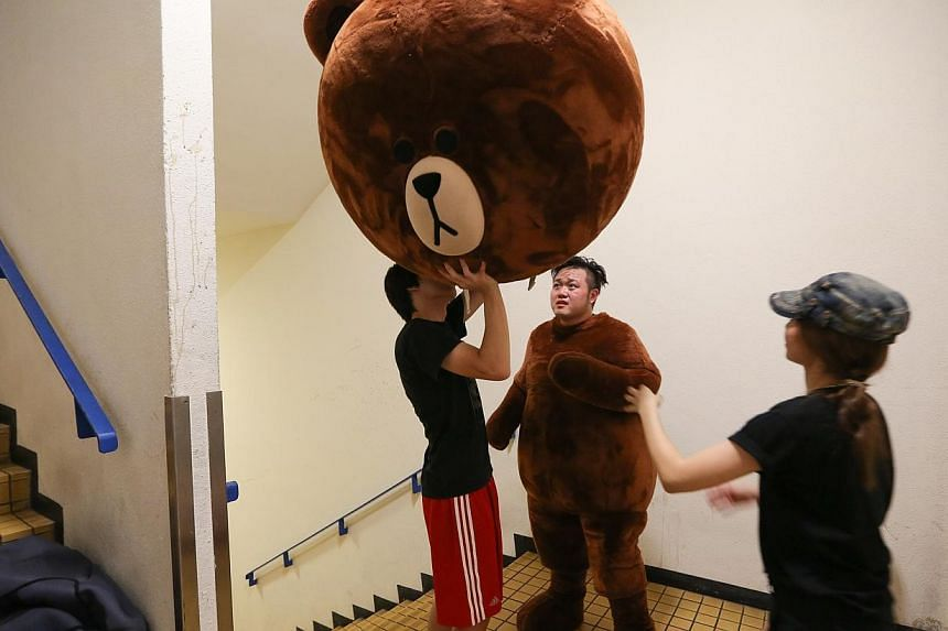 """Mr Alex Wee, disguising himself in a Line mascot called """"Brown"""". -- ST PHOTO:ONG WEE JIN"""