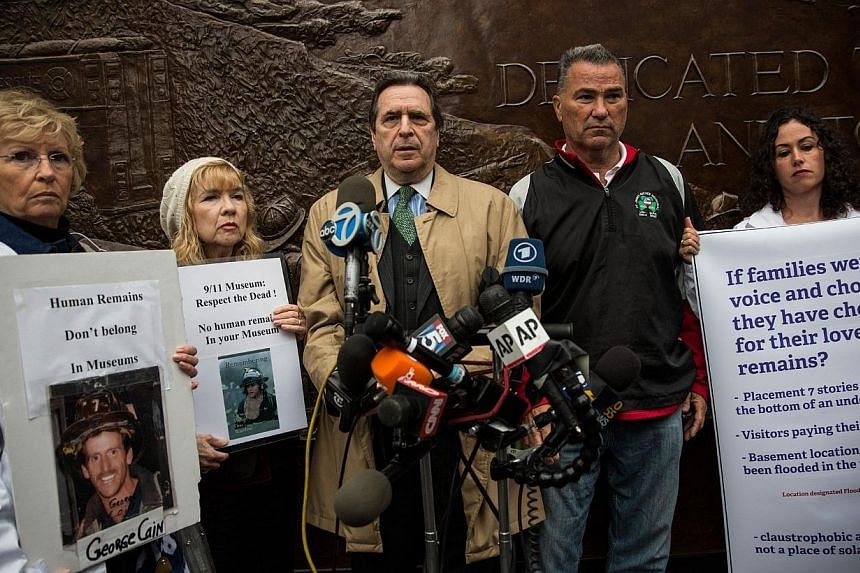 Attorney Norman Siegel (centre) and loved ones of people who died on the Sept 11, 2001, attacks hold a press conference opposing the placement of unknown human remains of victims in the basement of the 9/11 Museum at Ground Zero on May 8, 2014 in New