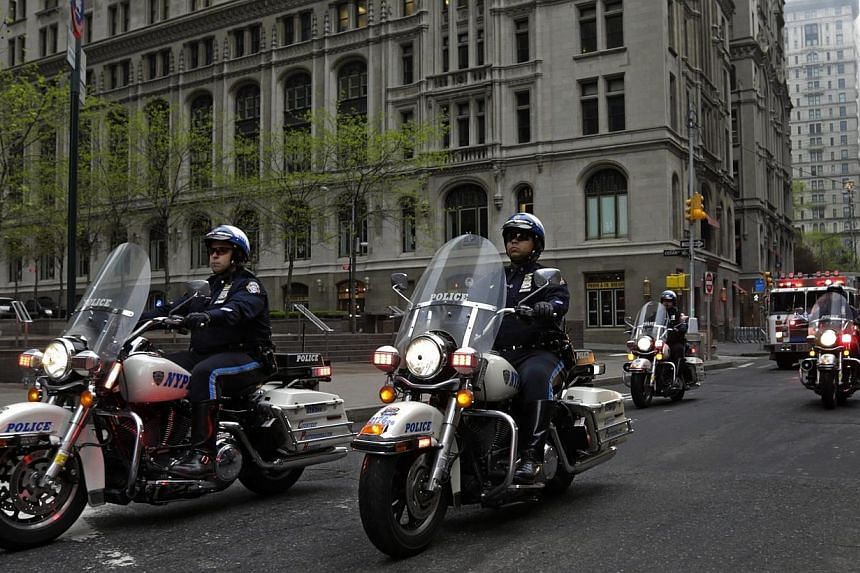 A motorcade carrying the unidentified remains of victims of the Sept 11, 2001, attacks is escorted by New York City motorcycle police to a repository at Ground Zero in New York, US, on May 10, 2014.  -- PHOTO: EPA