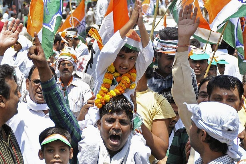 Supporters of Rahul Gandhi, India's ruling Congress party's vice president and son of Congress chief Sonia Gandhi, cheer during a road show ahead of the last phase of India's general election in the northern Indian city of Varanasi on May 10, 2014.&n