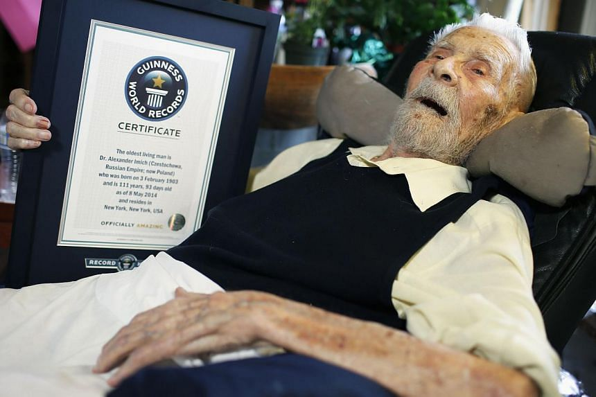 111-year-old Alexander Imich holds a Guinness World Records certificate recognizing him as the world's oldest living man during an interview with Reuters at his home on New York City's upper west side on May 9, 2014. -- PHOTO: REUTERS