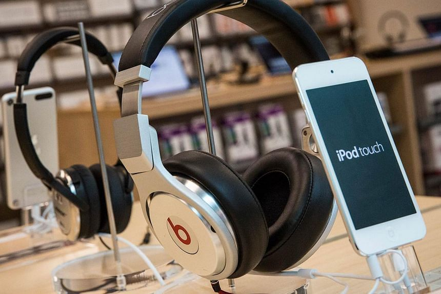 An Apple buy-out of hip headphone maker Beats Electronics could expand the iPhone maker's lucrative domain and play into plans for its next big thing, analysts said Friday. -- PHOTO: AFP